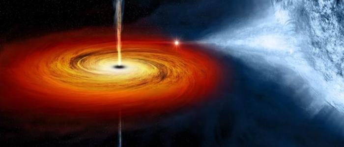 Una illustrazione di un buco nero che divora una stella